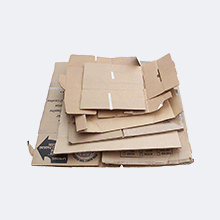 Flattened and stacked cardboard box